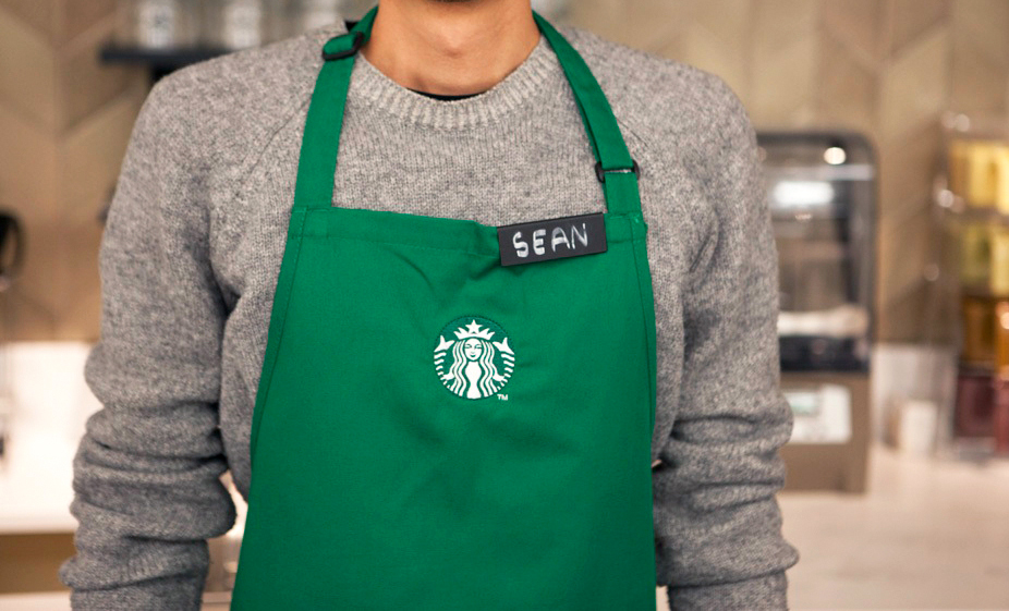 Woohoo! Get wild, all ye Starbucks employees. Now crew necks are acceptable work wear!